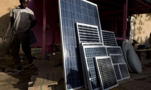 Solar panels on sale in a market in the northern Malian city of Gao, 2013