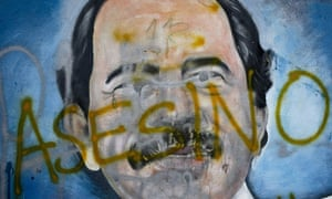 A mural in Managua of Nicaragua's president, Daniel Ortega, defaced with the word 'murderer'