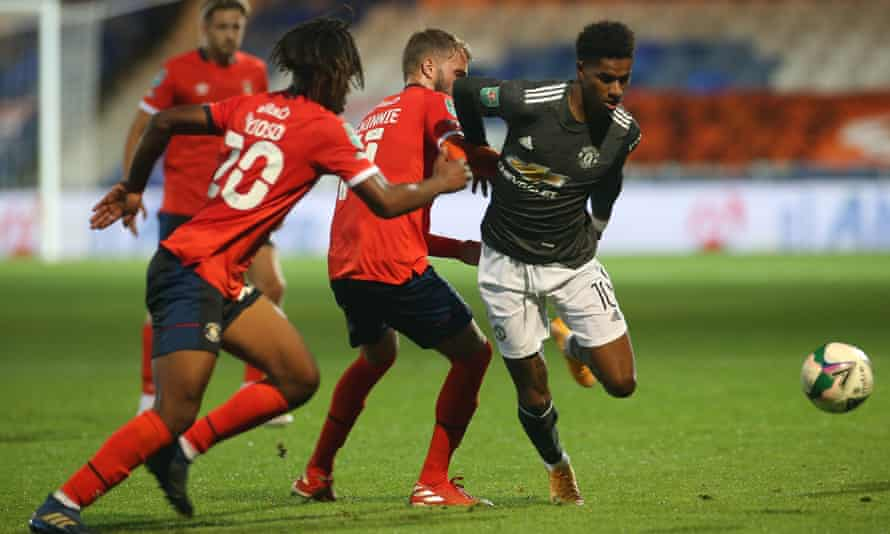 Manchester United's Marcus Rashford in action at Luton in the Carabao Cup third round, one of several recent meetings between Premier League and EFL clubs.
