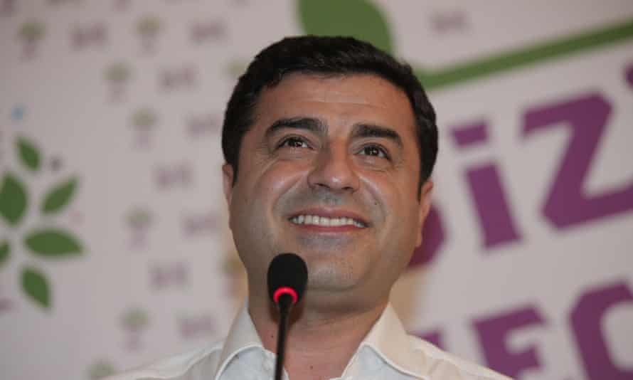 Selahattin Demirtas, co-chair of the pro-Kurdish Peoples' Democratic Party, smiles after his party's breakthrough in Sunday's elections.
