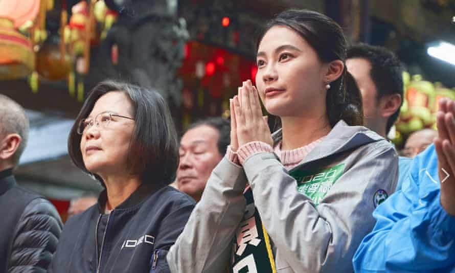 Lai Pin-yu, part of Taiwan's 'Squad' running for election in Taiwan, with president Tsai In-wen.
