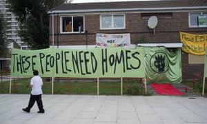 Banners outside a house at a protest by Focus E15 Mothers at the Carpenters estate in Newham