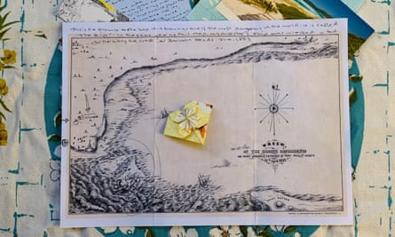 Old map, folded paper flower
