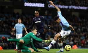 Gabriel Jesus tries and fails to take the ball around Lukasz Fabianski in the West Ham goal.
