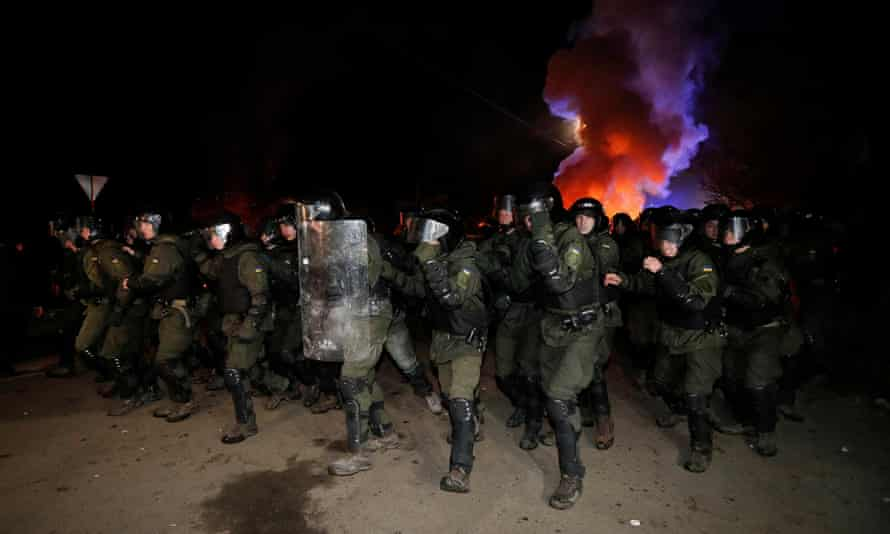 Police in Novi Sanzhary. Demonstrators, some of whom appeared drunk, put up road blocks, burned tyres and clashed with hundreds of riot police.