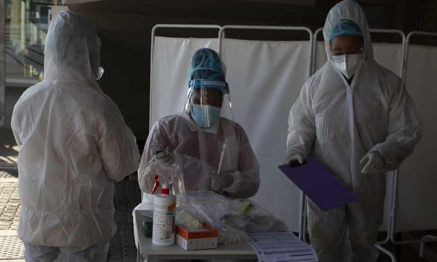 Healthcare workers prepare to test patients for Covid-19 at a facility in Johannesburg