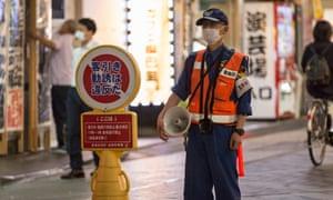 A security worker in Tokyo, Japan, this week
