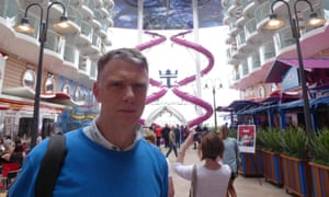 Sam Wollaston on board the Harmony of the Seas, with the purple Ultimate Abyss slide behind.