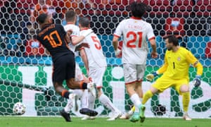 Netherlands' forward Memphis Depay (L) scores his team's opening goal.