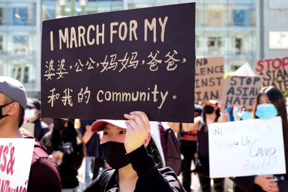 People take part in a rally against racism and violence on Asian Americans at the Union Square in San Francisco on 27 March.