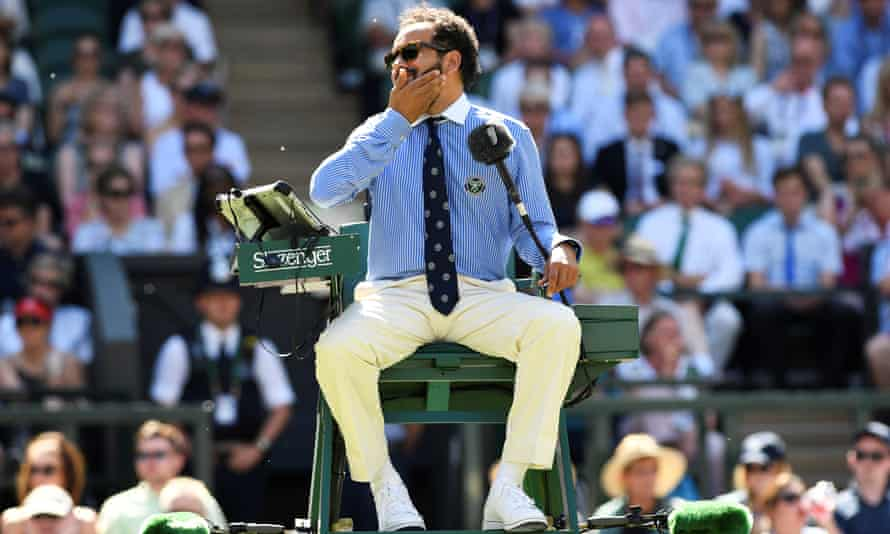 Kader Nouni, the umpire on centre court, reacts to the flying ants.