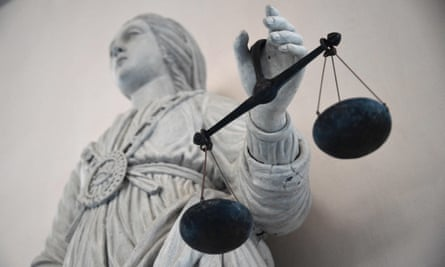 A statue of the goddess of justice balancing the scales at Rennes' courthouse on 19 May 2015.