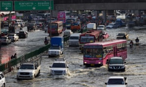 Traffic moves as floodwater takes over the streets in Bangkok in 2011.