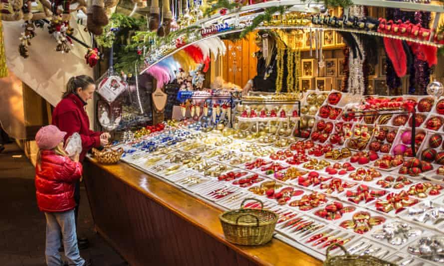 "Woman and little girl shopping for Christmas tree decoration baubles, at ""Christkindelsmarik"", Strasbourg"