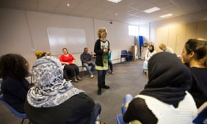 Refugees at an English lesson. The government has slashed funding to English as a second language (ESOL) courses by £138m since 2010.