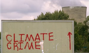 Climate change activists' graffiti on a billboard near the Didcot coal-fired power station in Oxfordshire, UK.