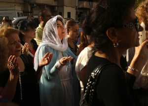 A Maronite Christian woman dressed as Virgin Mary during a procession marking the month of Virgin Mary in Jdeideh, Lebanon.
