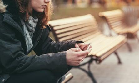 Teenage girl uses mobile phone.
