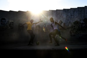 A game of football takes place in the streets of the Haitian capital.