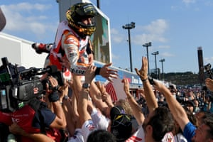Repsol Honda Team's Marc Marquez is tossed in the air by team members after winning the MotoGP race at the Japanese Grand Prix at the Twin Ring Motegi circuit in Motegi.