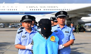 Telecom fraud suspects from Fiji arrive in Changchun, China after being deported.