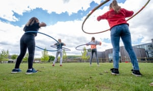 Children in a sports session with hoops