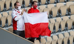 Fans hold up a Poland flag during the 2020 French Open final between Poland's Iga Swiatek and Sofia Kenin of the U.S.
