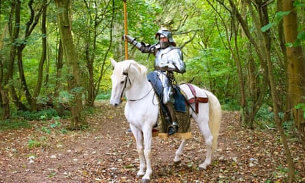 Jason Kingsley, video games developer and millionaire, rides his steed Warlord in the forest.