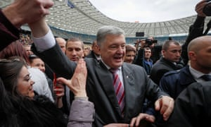 Ukraine's president, Poroshenko, greets supporters at the Olympic Stadium in Kyiv last weekend.