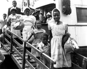 A family disembark from the Begona liner