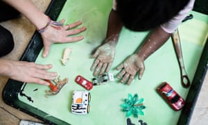 Children take part in messy play at the Magpie project