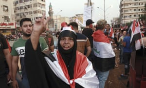 Anti-government protesters gather in Tahrir Square, Baghdad, during ongoing protests in Iraq on Friday.