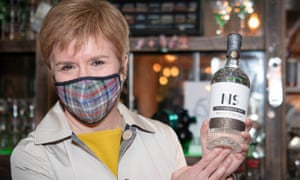 Nicola Sturgeon with a personalised bottle of gin during a campaign visit to the Edinburgh Gin Distillery in Edinburgh today.