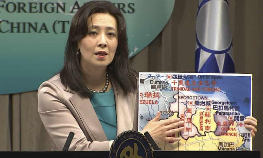 Joanne Ou, Taiwan's Ministry of Foreign Affairs spokeswoman, points at a map of Guyana at a weekly press conference in Taipei on 4 February.