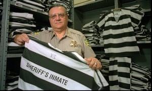 Joe Arpaio displays a prisoner uniform, in 1997.
