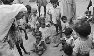 Mother Teresa talks with orphaned children at the Missionaries of Charity children's home