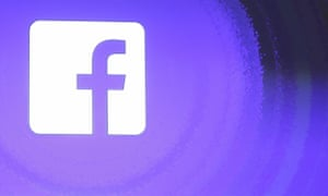 A photo of the Facebook logo against a blue background inside the company's headquarters in Menlo Park, California