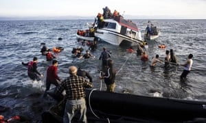Local people on the island of Lesbos help bring migrants to safety