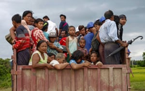 Rakhine people in Yathae Taung, Myanmar, flee a conflict area. Thousands are travelling across the border to Bangladesh after violence erupted between the army and Rohingya Muslims in the impoverished state of Rakhine on Friday