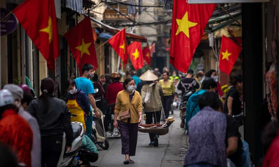 Shoppers wear face masks at a market in Hanoi