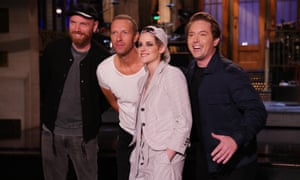 Johnny Buckland and Chris Martin of Coldplay, with host Kristen Stewart and Beck Bennett.