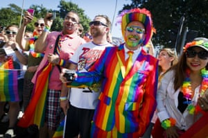 Rainbow-suited reveller