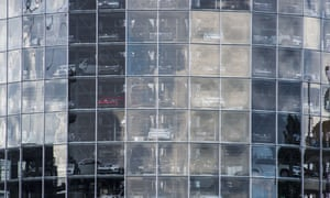 Volkswagen cars stacked up in a glass tower at the company's Wolfsburg HQ.