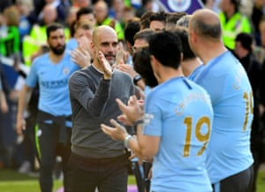 Guardiola celebrates with his back-room staff.