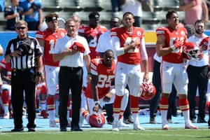 Kansas City Chiefs defensive end Chris Jones kneels in protest during the national anthem before the game against the Los Angeles Chargers