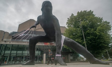 The Messenger sculpture outside Theatre Royal Plymouth, wrapped for the #MissingLiveTheatre campaign.
