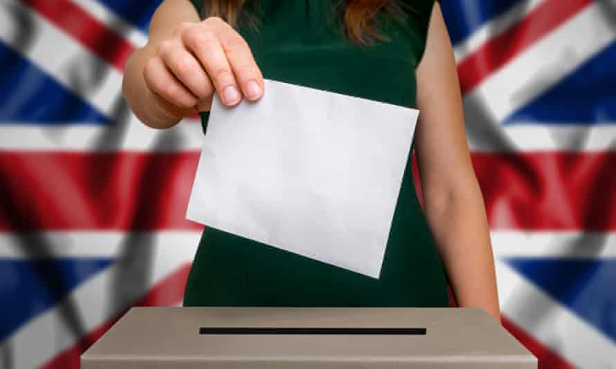 A woman putting her vote in the ballot box