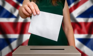 a woman holding a card over a ballot box with union flag background