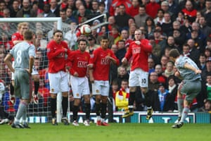 Fabio Aurelio curls in the free-kick for Liverpool's third, after Nemanja Vidic had been sent off for a second yellow card, having fouled Steven Gerrard.