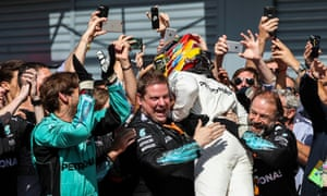 Lewis Hamilton celebrates with his Mercedes team.